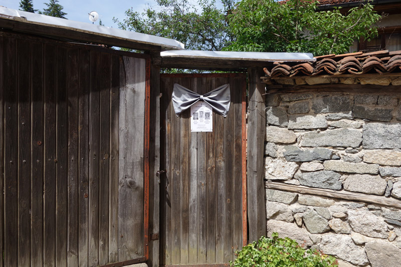 Death(memorial) notices on the entrance door with a silver bow @Koprivshtitsa (コプリフシツァ) Bulgaria