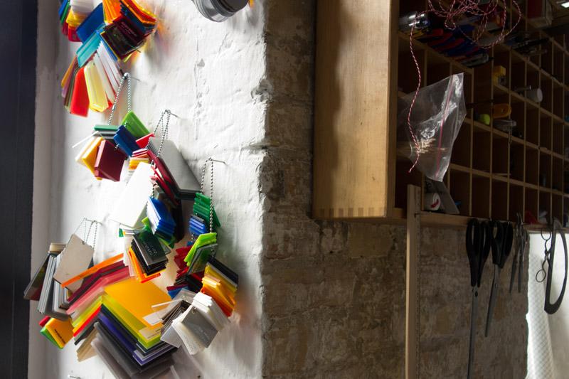 in the studio: acrylic glass Plexiglas samples hanging on the wall・アクリルのサンプル@マーティンのスタジオ